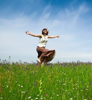 Woman dancing in a field picture