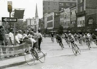 Bicyclists rounding the corner of a designated street race course
