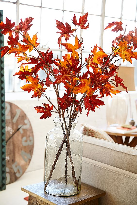 Fall stems displayed in a vase. - big glass vase