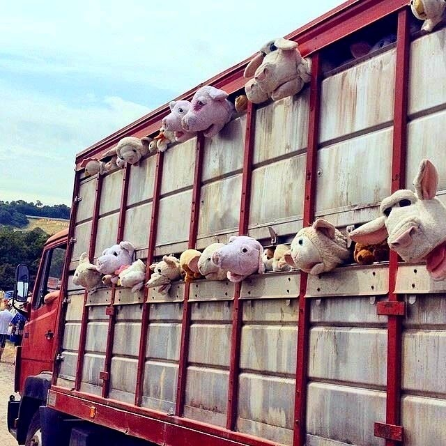 "Earlier today, Banksy brought his NYC ""Sirens Of The Lambs"" meat truck, stuffed with farmyard animals to Glastonbury Festival."