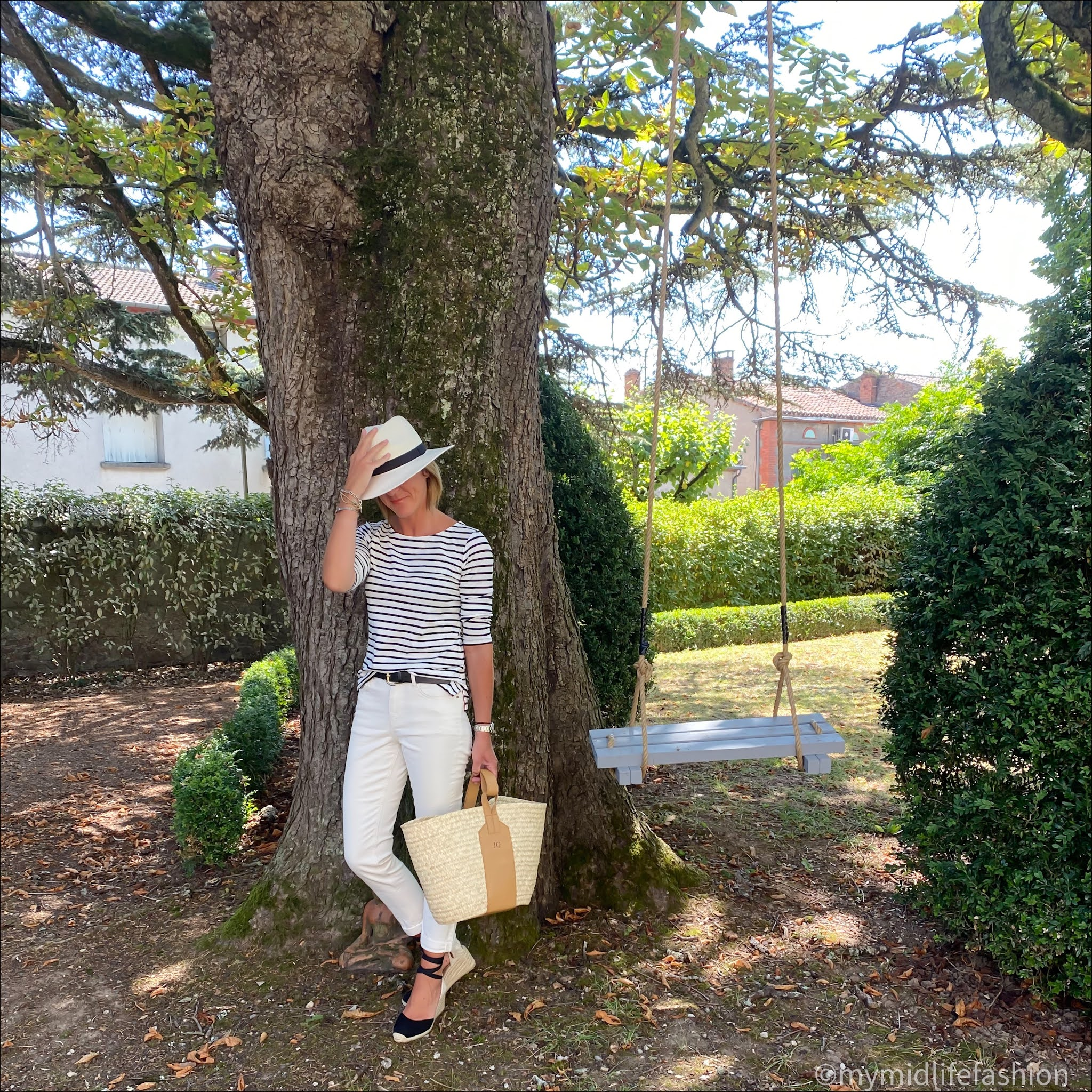 my midlife fashion, boden long sleeve cotton breton top, zara Panama hat, rae feather grace monogramme basket, boden leather belt, boden girlfriend jeans, boden Cassie espadrille wedge heels