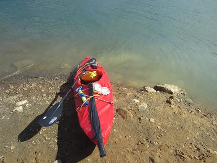PVC fabric skin-on-frame kayak on shore