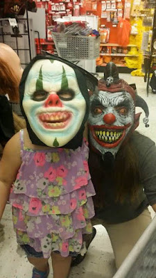 party city fun, party city clown maks, scary clown masks, family fun at party city,