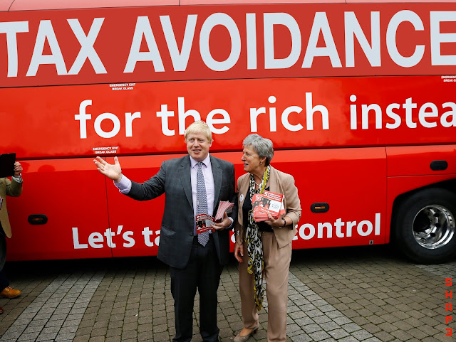 Boris Johnson stands in front of Photoshopped Brexit Bus NHS