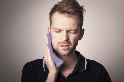 Ilustrasi gambar cara menghilangkan sakit gigi