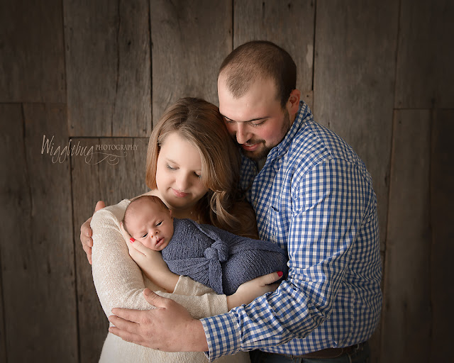 Newborn Baby Boy and family in the DeKalb IL photography studio of Wigglebug Photography