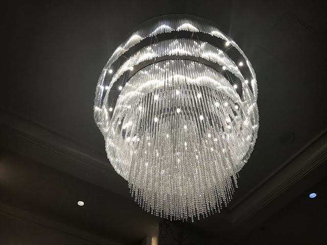 Crystal Chandelier hanging from ceiling at Costero Bar and Bistro in Los Angeles, California