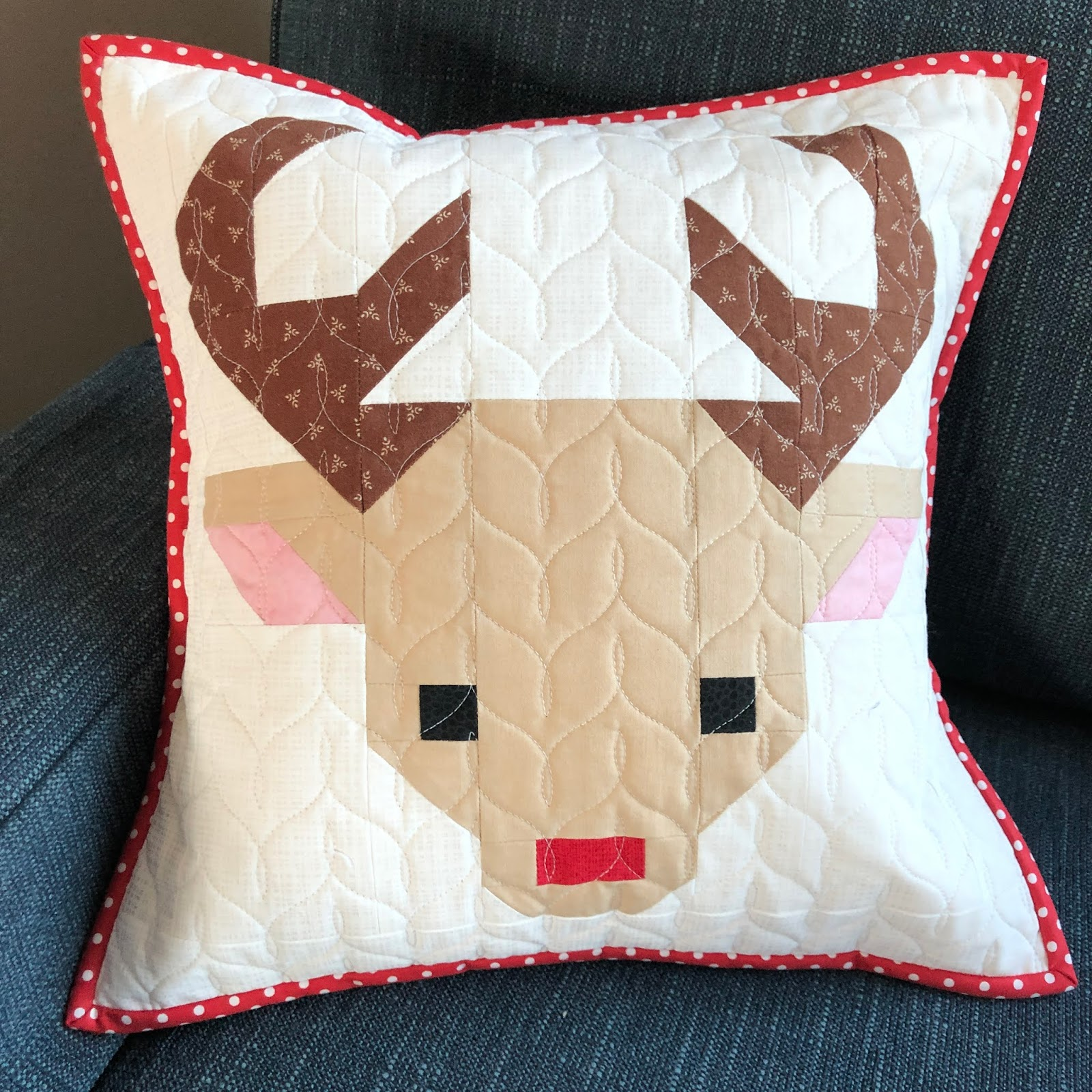 pieced and quilted reindeer head pillow
