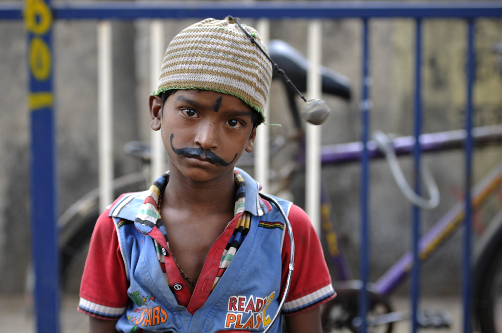 Boy in Mumbai, India is one of the many new photographs taken by the photographer from his latest journey to India.