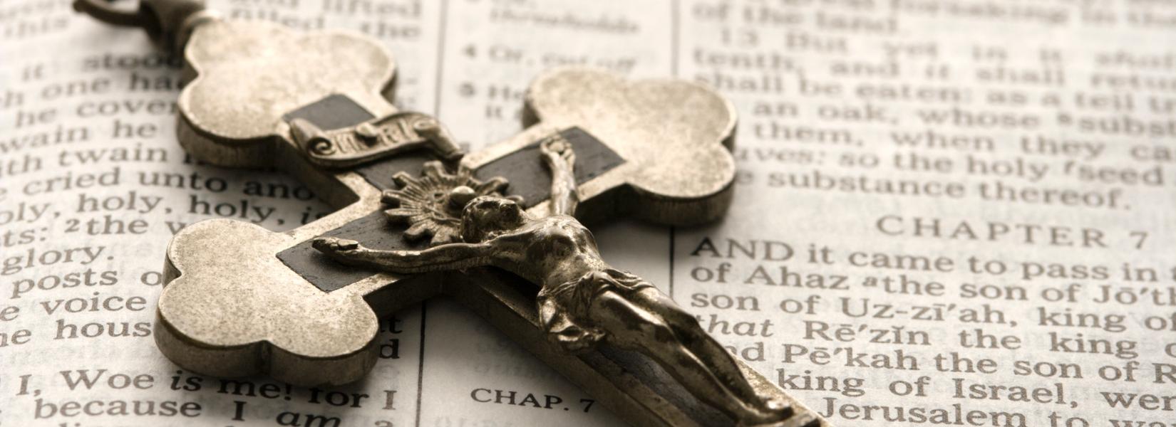 Cross on top of open bible