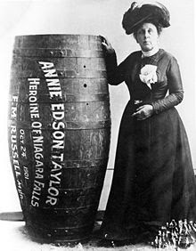 Annie Edson Taylor standing next to her barrel