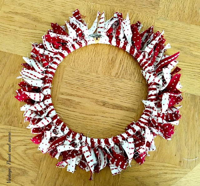 strips tied to a embroidery hoop to make a Valentine wreath