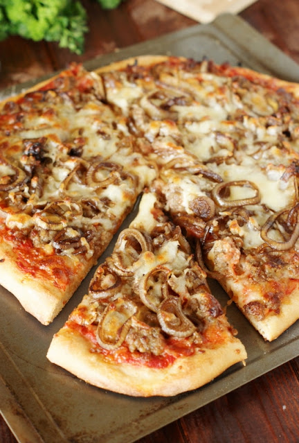 Recipes to Make with Sausage - Sausage & Caramelized Onion Pizza Image