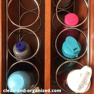 Use any available wine rack space to store your water bottles