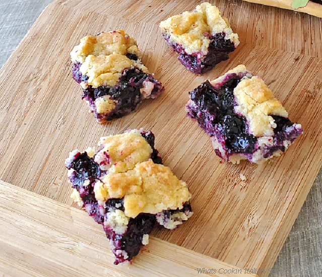 these are blueberry crumble bars on a cutting board cooling