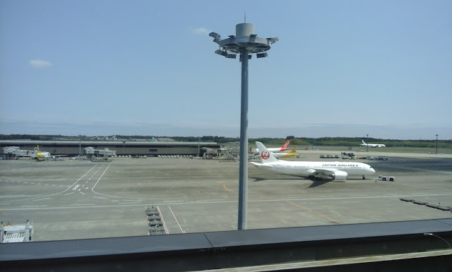 deck looking over airplais at narita airport, tokyo, japan