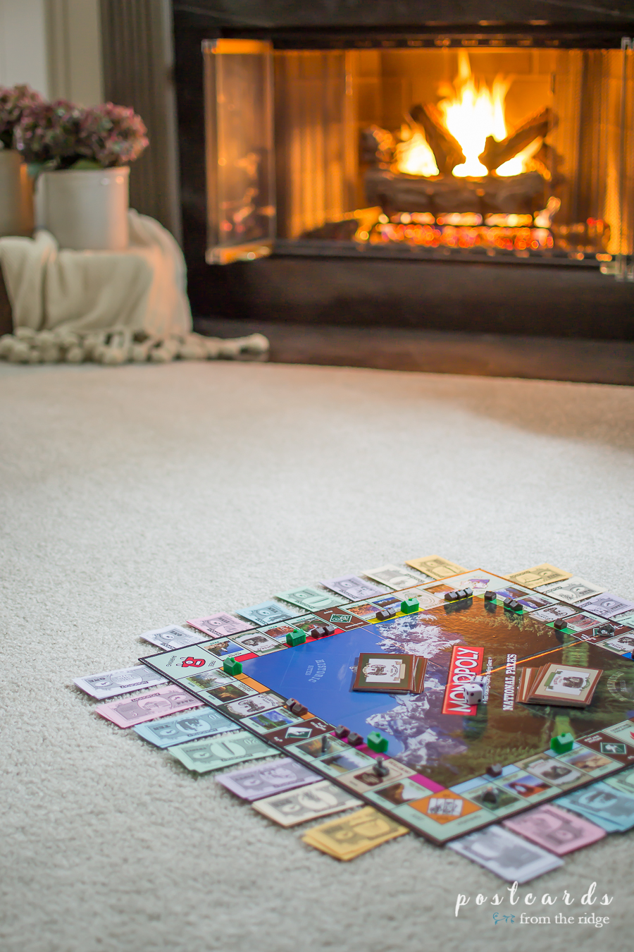cozy carpeted floor with game board and fireplace