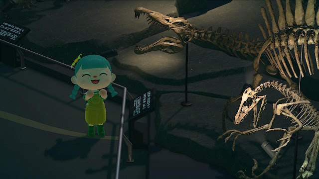 A screenshot of gameplay in Animal Crossing New Horizons. A character with turquoise hair is smiling at a dinosaur fossil in the museum