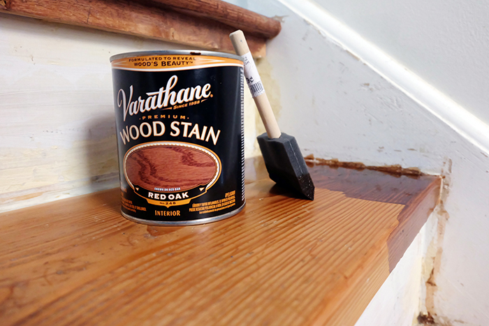 applying the oil based stain with a foam brush to the pine wood