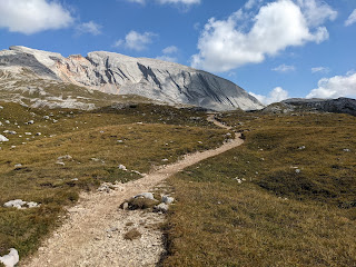 The path leading to Rifugio Biella and the formation called Croda del Becco.
