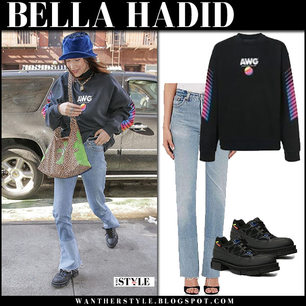 Bella Hadid in black alexander wang sweatshirt, jeans and black sneakers both model street style march 22