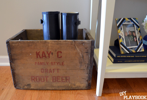 Boots in a vintage crate kay c draft root beer antique