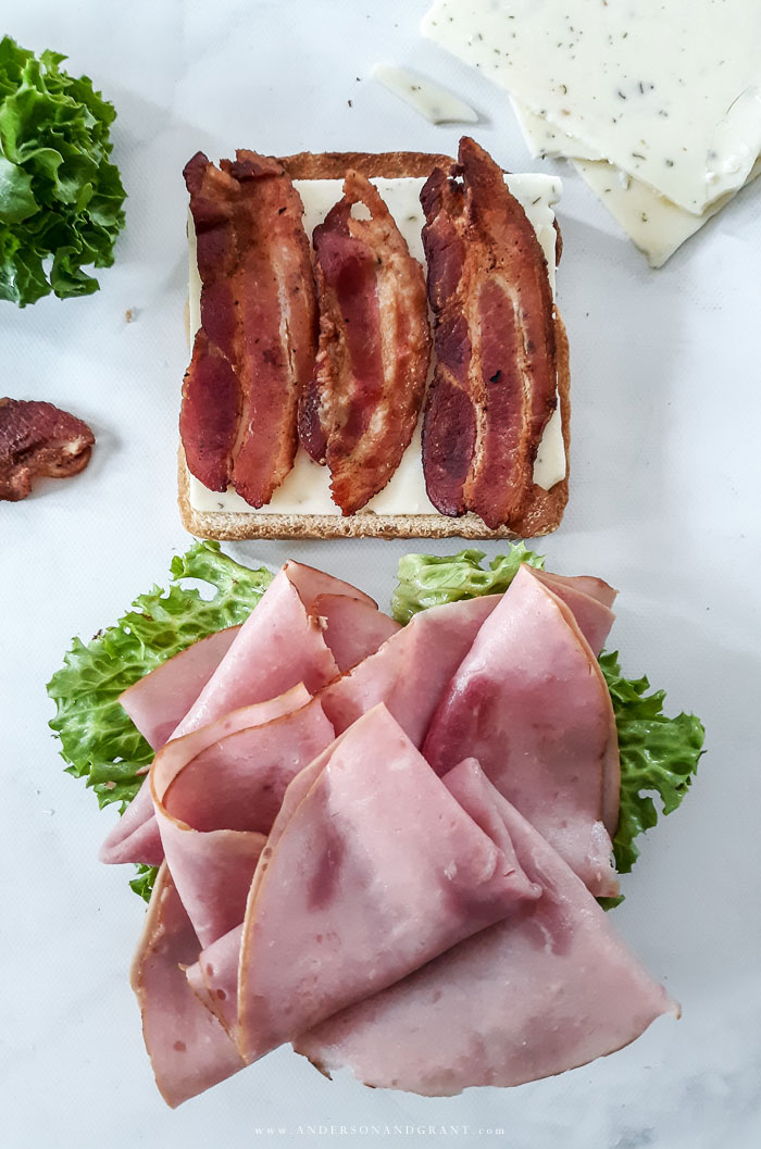 Preparing a Ham Club Sandwich