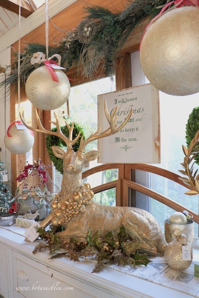 """A large 28.5"""" reclining gold deer is the centerpiece on a buffet in this year'sFrench Country Christmas Event"""