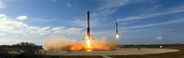 photo of Heavy Falcon side rockets returning in parallel landings