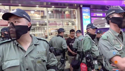 "HK police constantly conceal their identity with ""panty-masks"""
