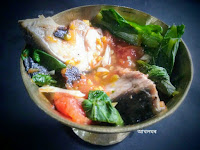 Boiled fish cooked with greens