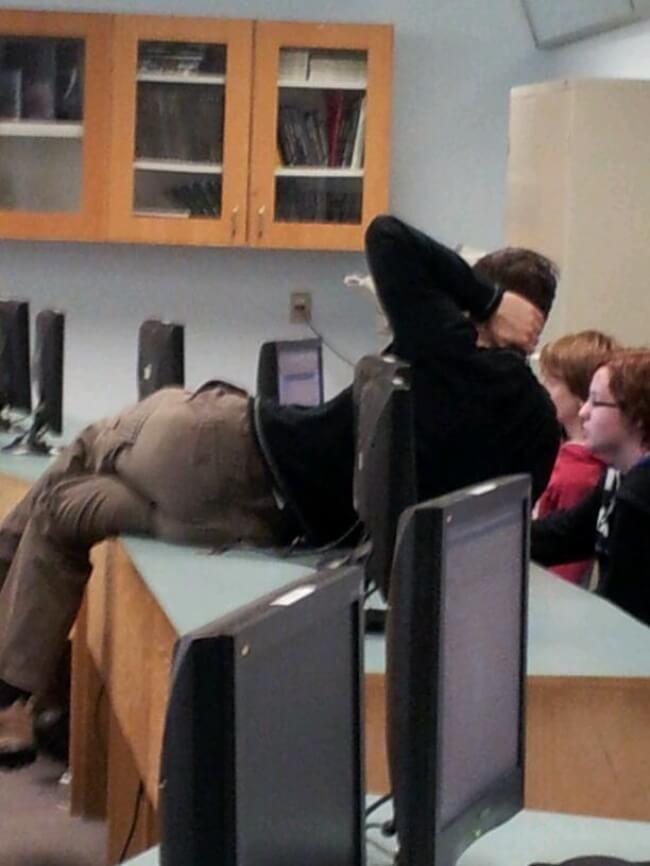 16 Inspiring Photos Prove That Teachers Can Have A Great Sense Of Humor - Why not lie down on the table It is easier than leaning across it.