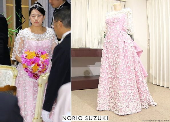 Princess Ayako wore a satin wedding dress by Designer Norio Suziki
