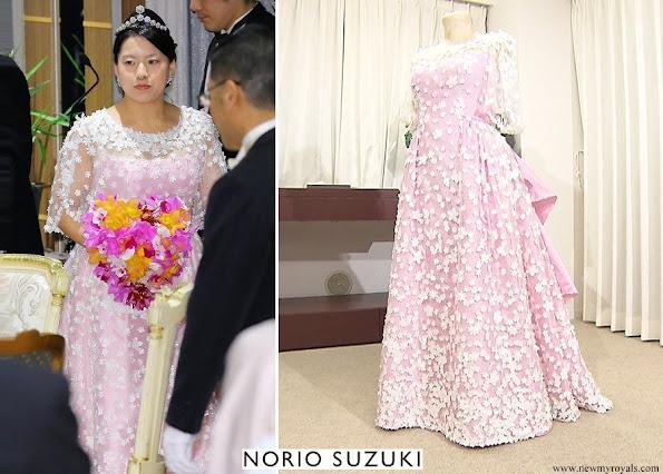 Princess Ayako wore a satin wedding dress by Designer Norio Suziki