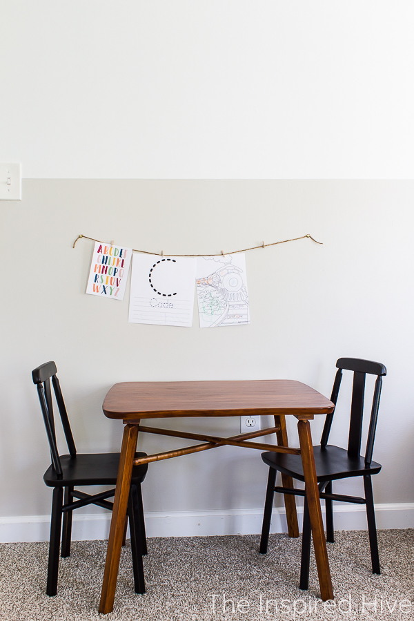 Antique wood kids' activity table with black chairs