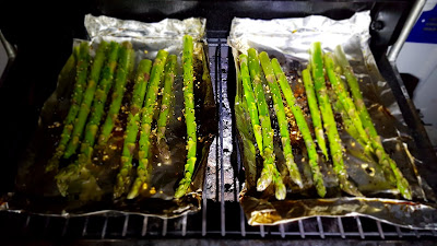 Asparagus cooking in trays with the left over fat from the Chicken. Just cook till crisp.