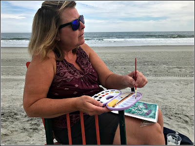 February 28, 2019 Watching my sister paint on the beach.