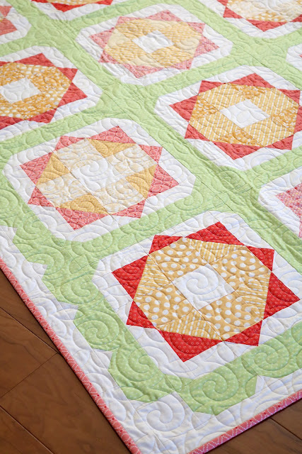 Sunny Day quilt pattern from the Fresh Fat Quarter Quilts book by Andy Knowlton of A Bright Corner - uses 12 fat quarters and has a fun scallop border - perfect spring quilt