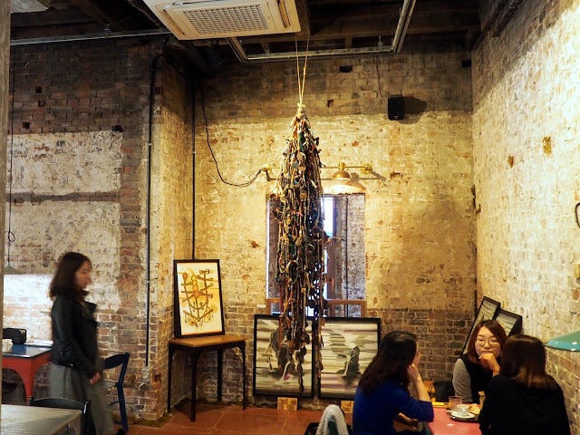 Cafe interior details - exposed brickwork and rope/cable art installation in Brown Hands Design Cafe near Busan Station, South Korea