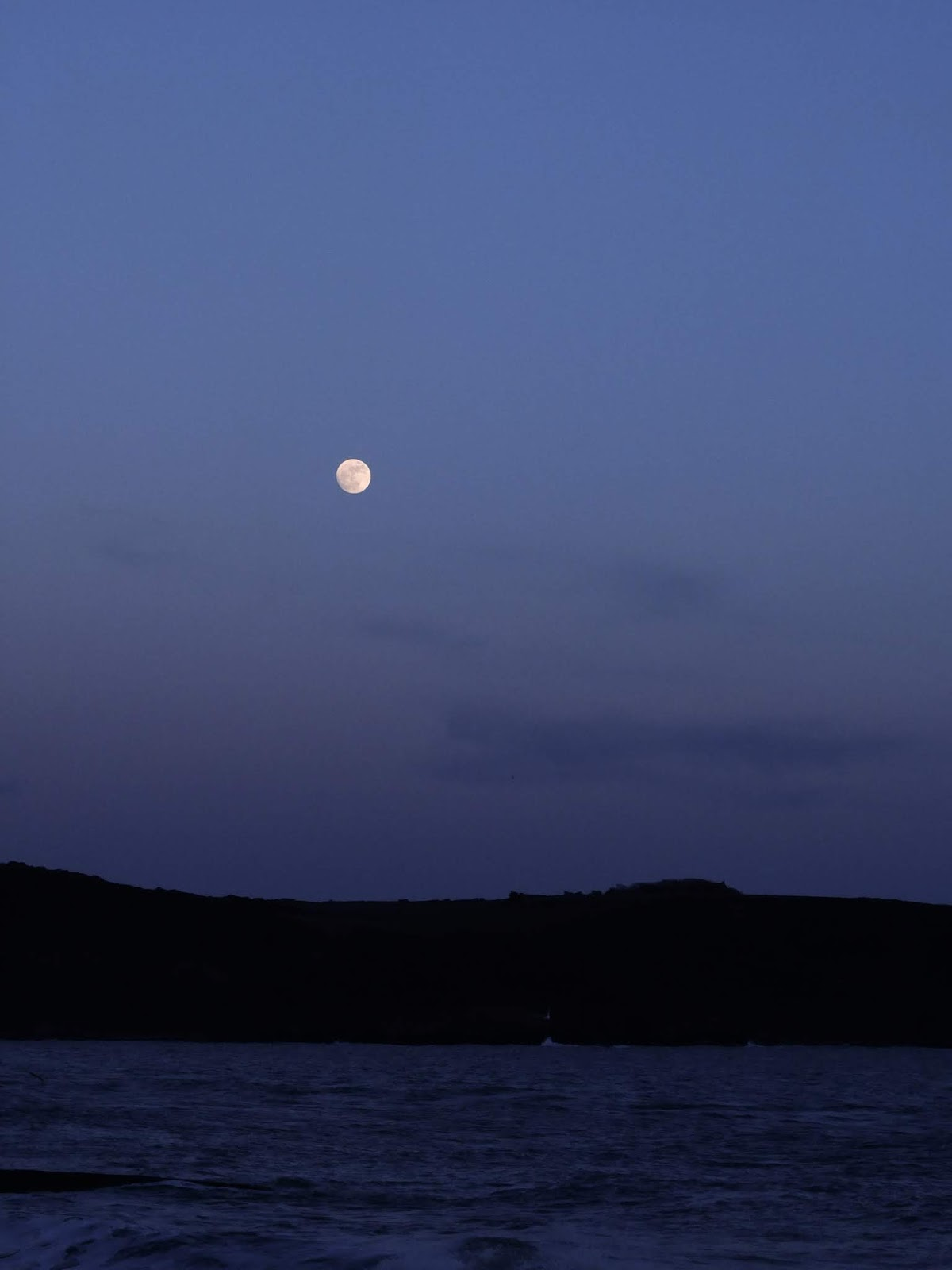 Moon rise during blue hour over the ocean in Youghal, Co.Cork.