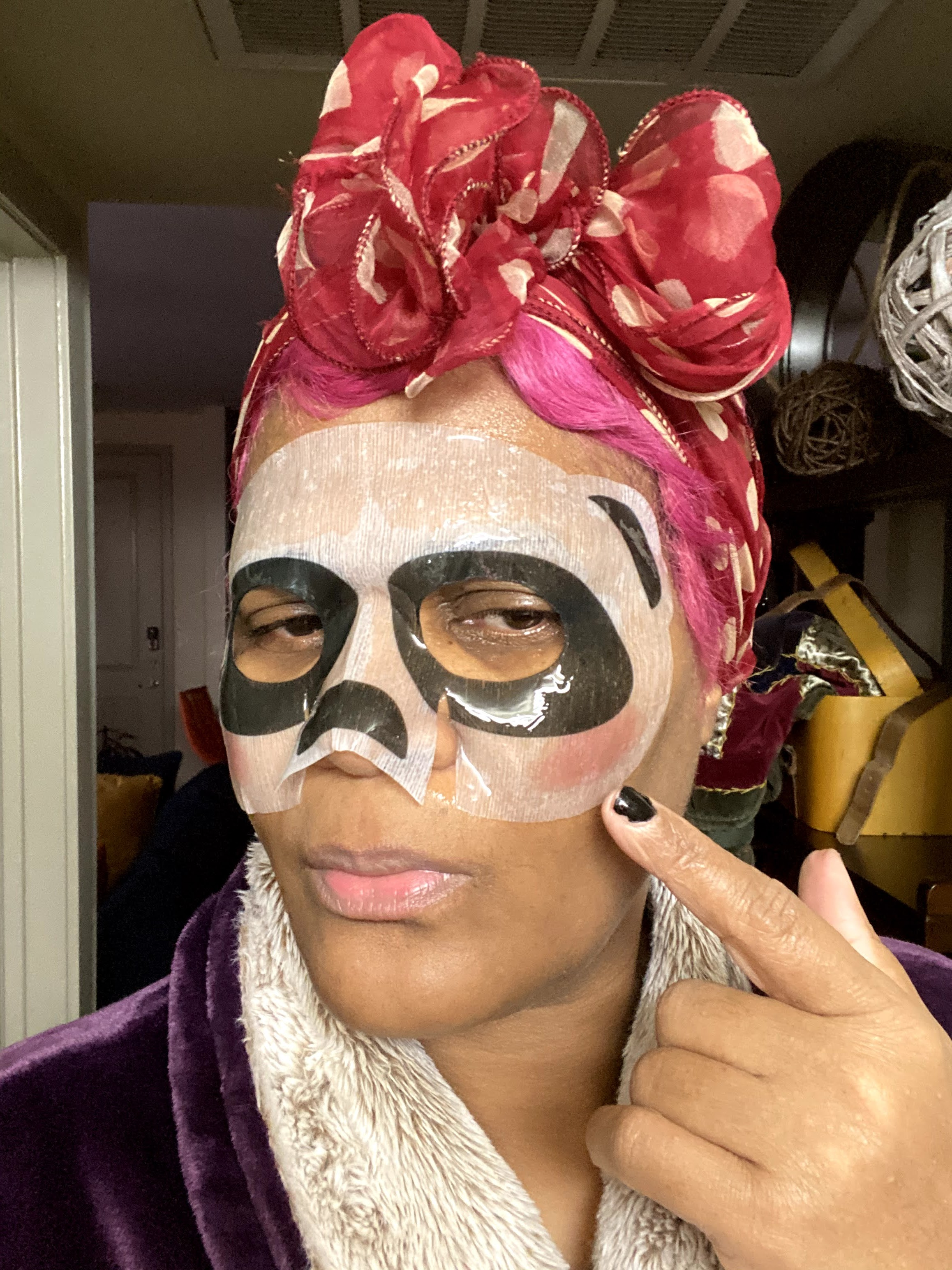 Tangie Bell trying on a new panda eye face mask