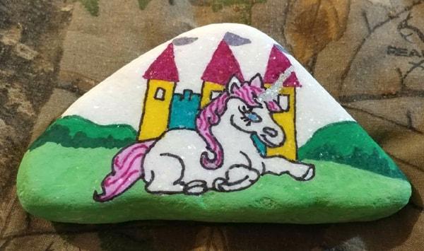 rock painting ideas - unicorn by a castle