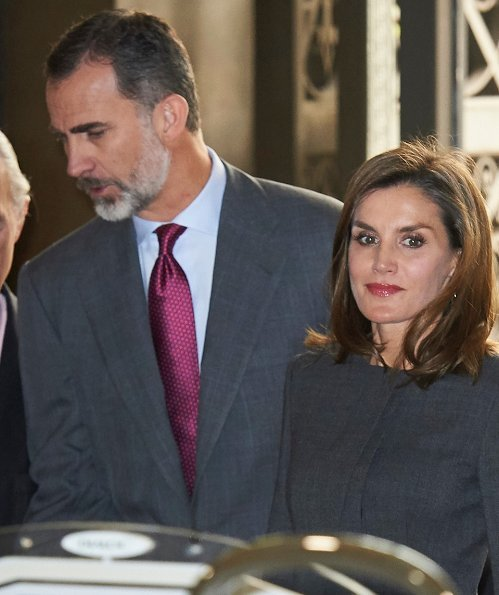 Queen Letizia carries Madmacarena python snake clutch bag. Uterque shoes, diamond jewellery earring