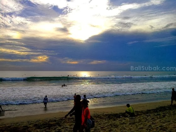 Sunset in Kuta Beach blocked by the clouds