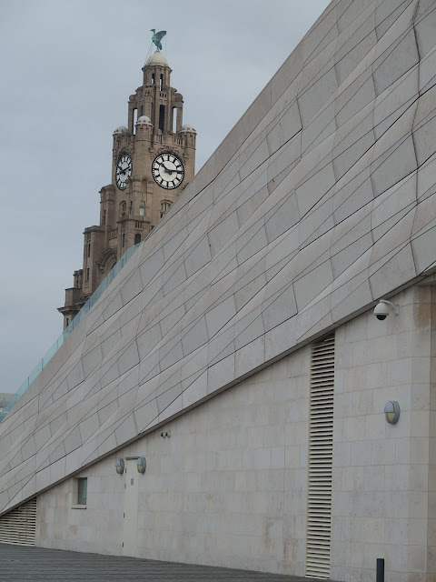 The Royal Liver Building playing 'peek a boo' with the Museum of Liverpool