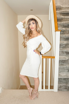The Femme Luxe White Belted Bodycon Midi Dress in model Angelica.