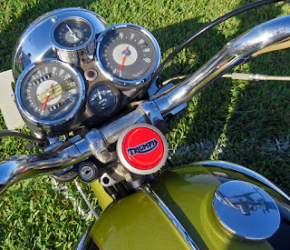 Motorcycle instrument cluster includes boost gauge.