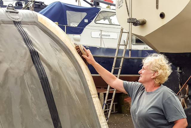 "Photo of me giving the ""new"" dinghy a good scrub"
