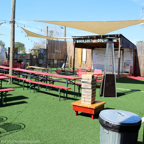 beer garden with picnic tables and a stage