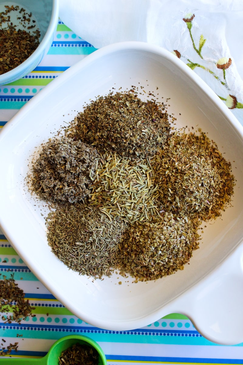 Make a batch of Homemade Italian Seasoning to use in all of your favorite Italian inspired dishes. This simple blend of herbs will earn a permanent spot in your spice cabinet! #italianseasoning #homemadeseasoning